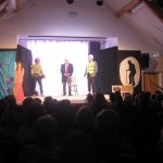 Actors performing on the stage at the Ashurst Village Hall